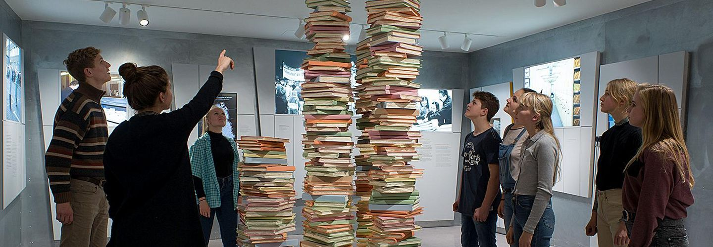Stack of Documents with young people surrounding