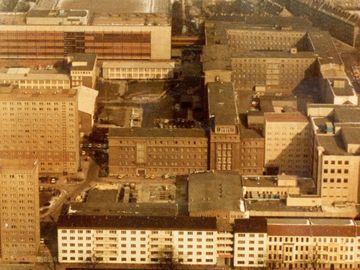 "This aerial view show the archive buildings ""Haus 8"" and Haus 9"" at the bottom right, behind the 5-story building phalanx on Frankfurter Allee"